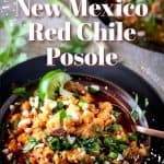 NM Red Chile Posole in a bronze bowl with copper spoon, lime wedge, fresh cilantro.