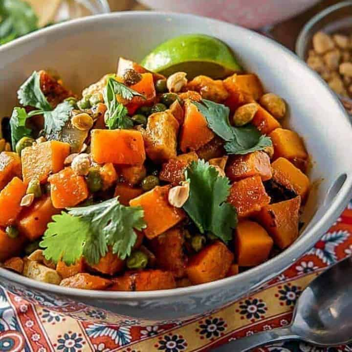 Thai Butternut Squash Curry in a round white bowl square image.