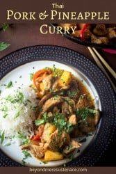 A Pinterest pin of Thai pork and pineapple stir fry and rice on a bronze-rimmed plate.