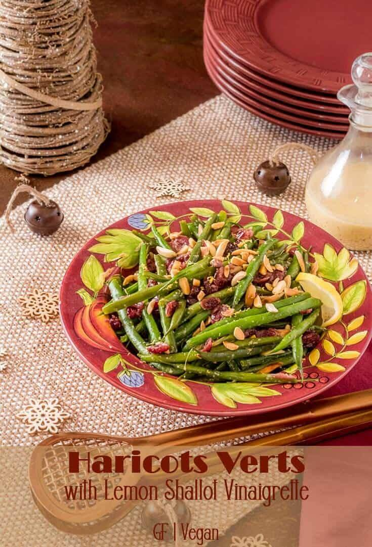 A light, healthy green bean dish that provides a lovely counterpoint to the heavy, rich dishes that are typically on your holiday table... Haricots Verts with Lemon Shallot Vinaigrette is ready in a flash, and you can make it in advance! The homemade vinaigrette makes this extra special and it's so easy. #greenbeans #haricotsverts #Christmassides #Thanksgivingsides #sidedishes #healthysides #glutenfreesides #vegansides