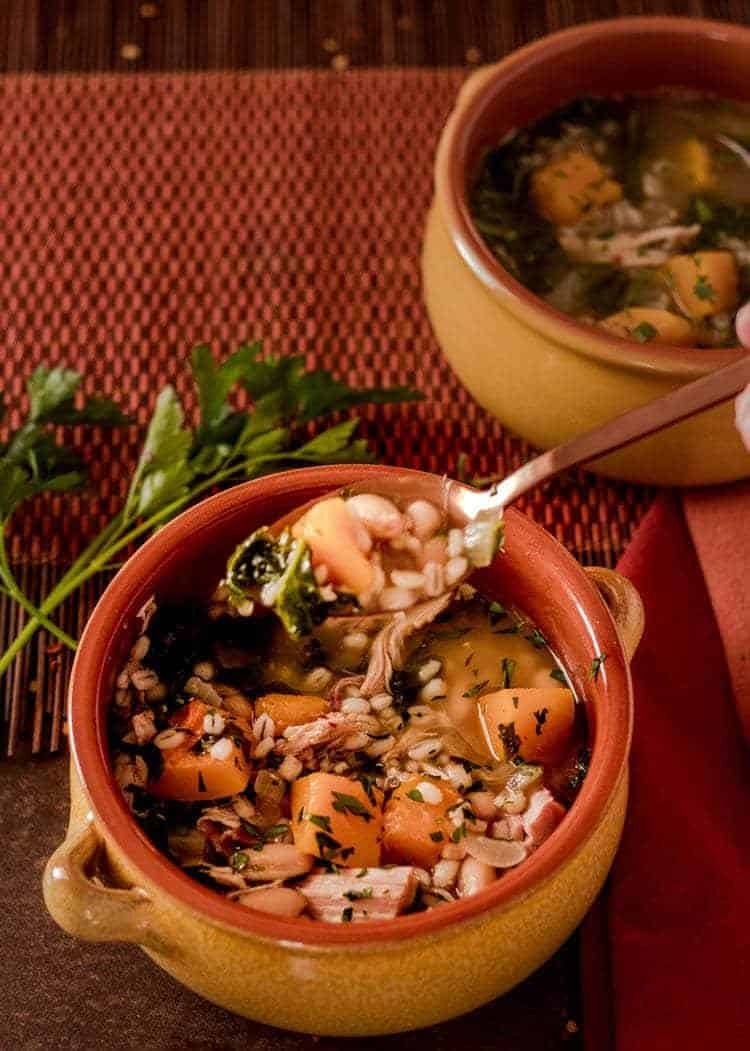 Smoked Turkey and Barley Soup with Kale and Butternut Squash taking a big bite! Yum!