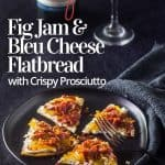 An easy flatbread appetizer on a black plate with black fork and grey napkin.