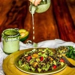 Cilantro Jalapeno Ranch Dressing - dressing being poured on to a plate of salad.