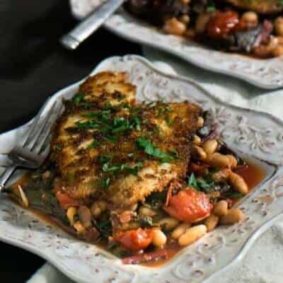 Spanish Fish With Chard, Cannelini, and Tomatoes