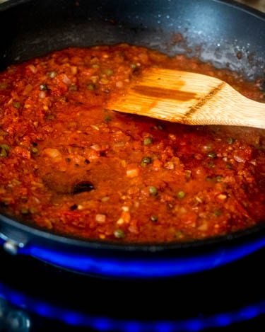 The remaining ingredients for the Mediterranean style sauce get simmered about 5 minutes.