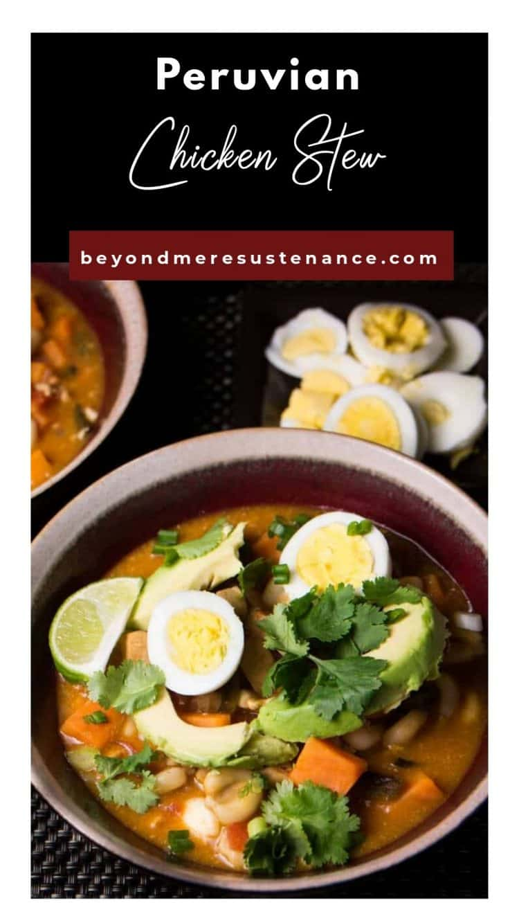 Peruvian Chicken Stew with Corn in a red bowl with avocado and cilantro.