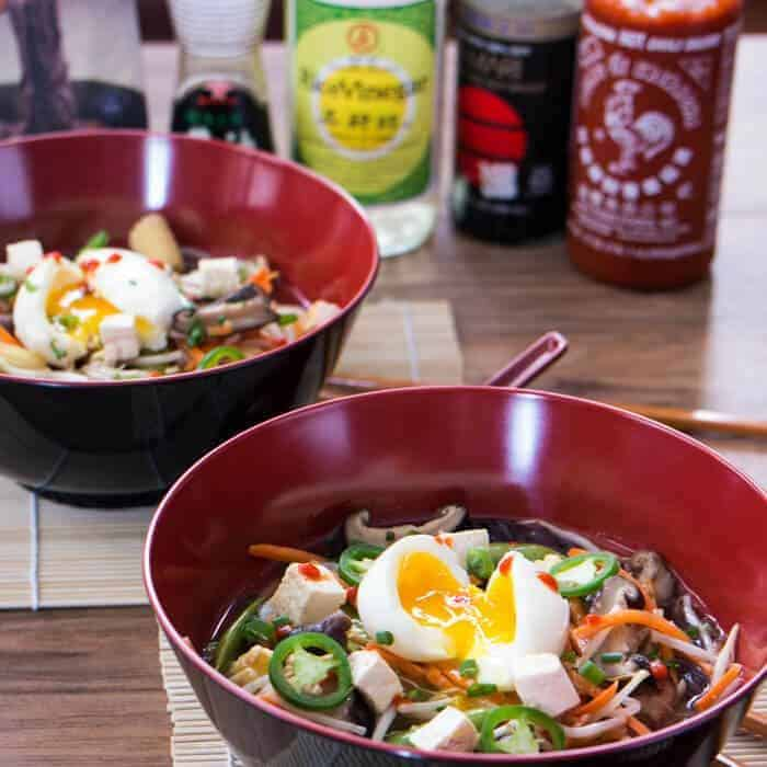 Evan's Tofu and Miso Ramen in large Asian soup bowls topped with soft eggs.