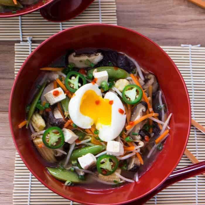 Tofu and Miso Ramen bird's eye shot with chopsticks in a big red bowl.