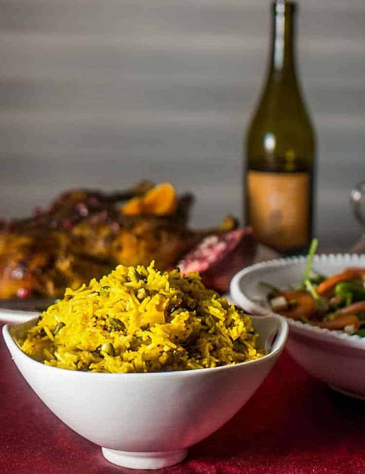 Persian-Inspired Pistachio Pilaf with turkey, salad, and a bottle of wine.