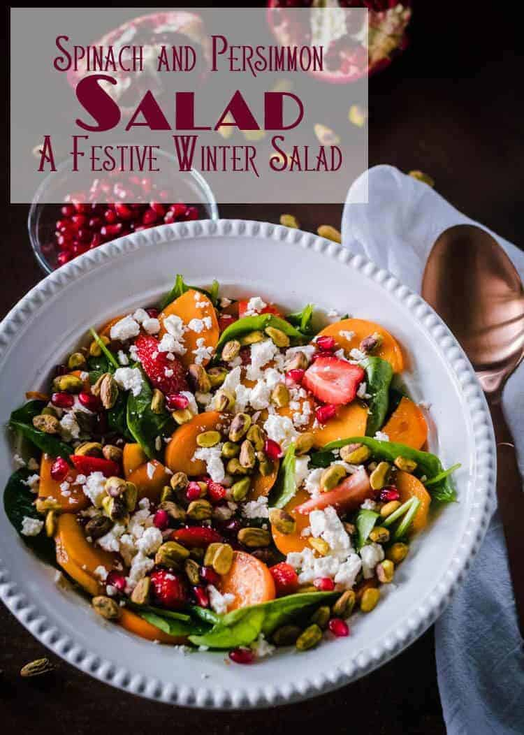 Spinach and Persimmon Salad with Citrus Dressing combines a sweet fuyu persimmon and strawberries with salty feta cheese and pistachios in a spinach salad lightly dressed with a citrus marmalade-based dressing. A festive winter salad! #persimmonsalad #spinachsalad #wintersalad #holidaysides #holidaysalads