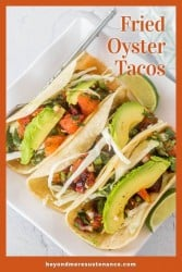 A Pinterest Pin close up of fried oyster tacos topped with citrus salsa and avocado.