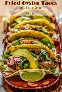 Fried Oyster Tacos with Citrus Salsa 5 tacos on a red tray.