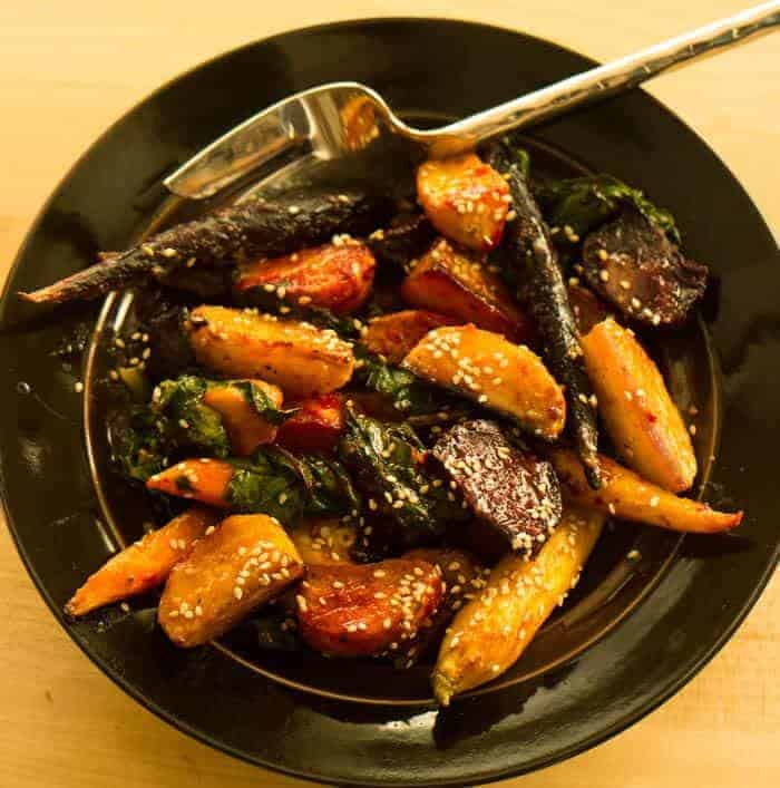 Orange Miso Glazed Beets and Carrots - prepared beets in a bronze serving bowl with a stainless steel serving fork.