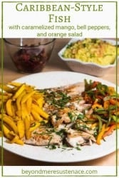 A pinterest pin of a white platter with caribbean style fish, mangoes, and bell pepper strips.