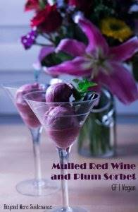 Mulled wine spices add vibrant flavor notes to this Mulled Red Wine and Plum Sorbet... A light, refreshing finish to any elegant meal with a sprig of mint and a square of dark chocolate! #glutenfreedessert #dairyfreedessert #sorbetrecipes #plumsorbet #ValentinesDaydesserts #mulledwinesorbet