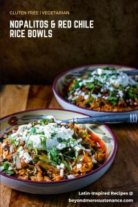 Nopalitos and Red Chile Rice Bowls in 2 shallow ceramic bowls on a wood background.