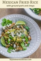 A Pinterest pin of Mexican fried rice with chaya and ground pork in a white bowl topped with avocado and cilantro.