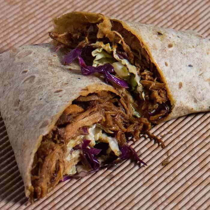 Instant Pot Korean-Style pulled pork wrap with Asian slaw and kimchi.