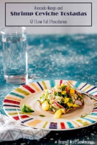 Shrimp Ceviche Tostadas on a bright striped place with a glass of water in the background