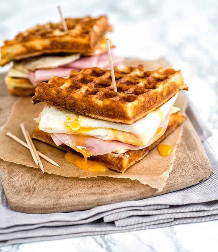 A savory parmesan waffle with ham, cheese and egg - a perfect breakfast sandwich!