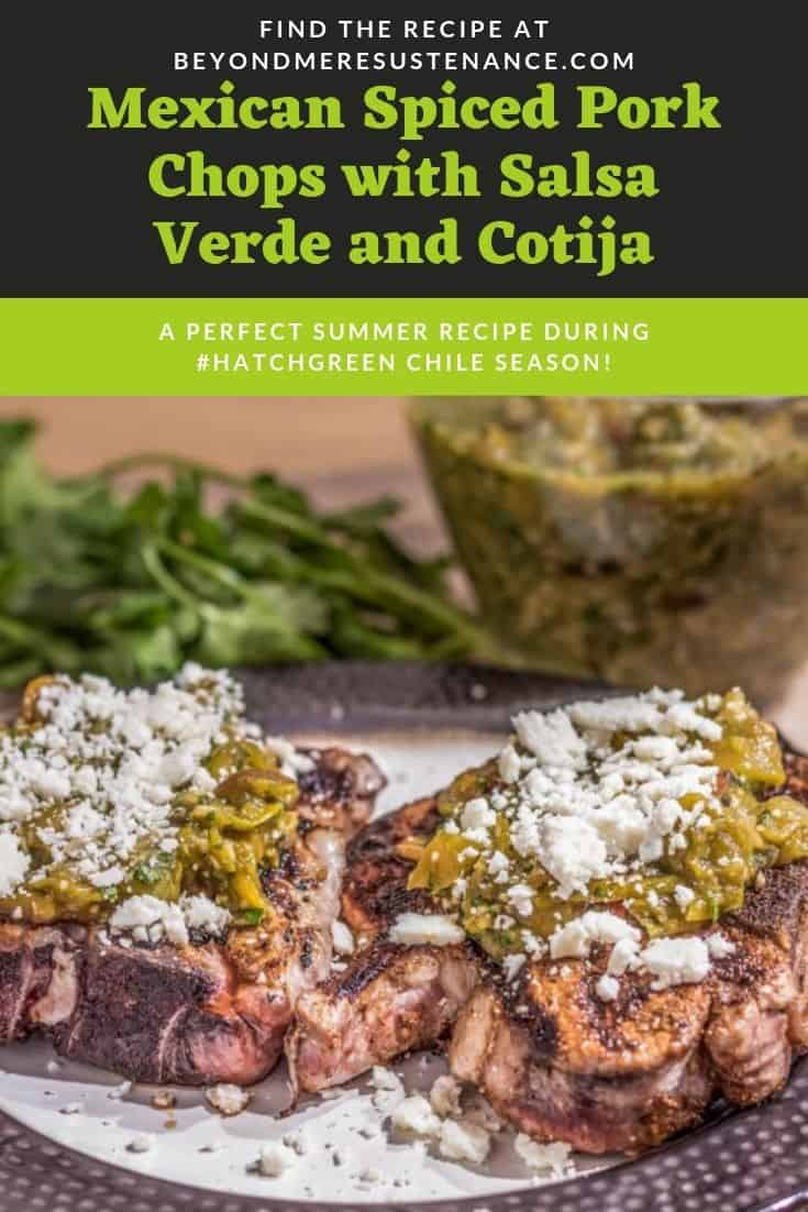 Mexican Spiced Pork Chops with Salsa Verde and Cotija on a bronze and white ceramic plate with a glass bowl of salsa verde and a bunch of fresh cilantro