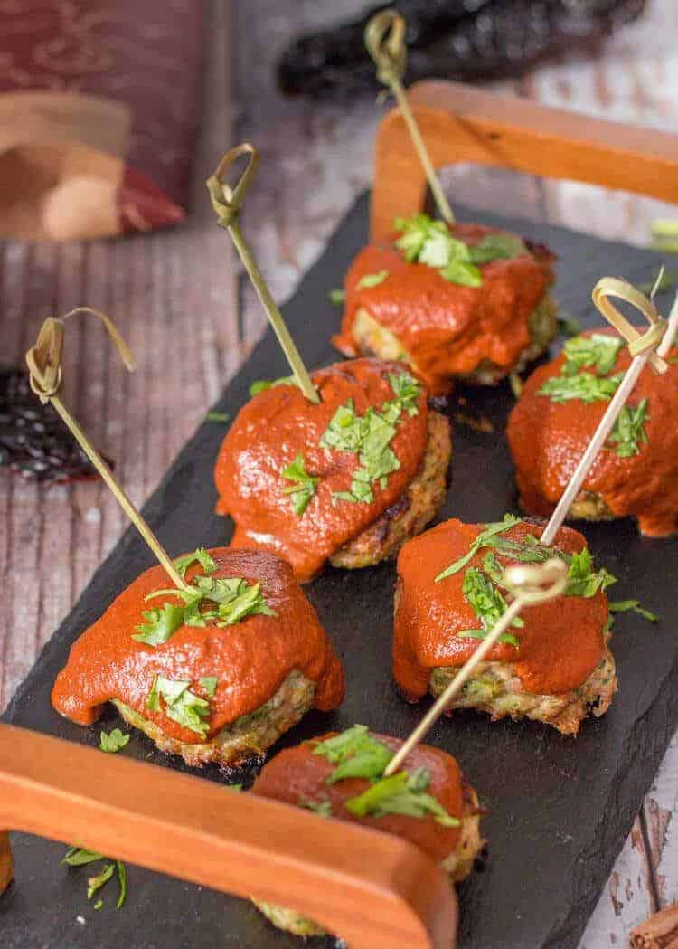 Ancho and Chocolate BBQ Sauce With Mexican Meatballs on a slate tray with toothpicks.