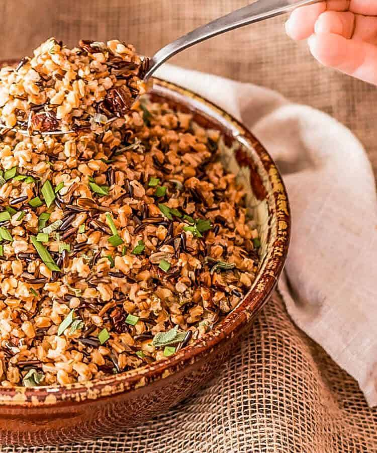 Instant Pot Farro and Wild Rice Pilaf in a red stoneware bowl with napkin.