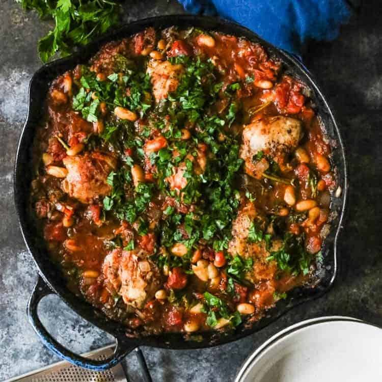 One-Skillet Braised Chicken Thighs with Spinach and White Beans