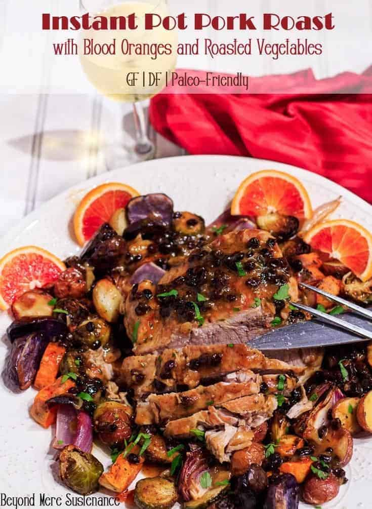 Succulent pork roast with the brilliant red juice of blood orange, the tang of mustard, herbal rosemary, and sweet currants! Instant Pot Pork Roast With Blood Oranges is an elegant and approachable main dish to grace the table shared with your Valentine and prepared in less time with your Instant Pot! #InstantPot #porkroast #pressurecooker #glutenfree #dairyfree #paleo #porkrecipes #bloodorange #Valentine'sDayMains