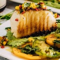 Mexican Grilled Sea Bass With Avocado Crema and Mango Salsa