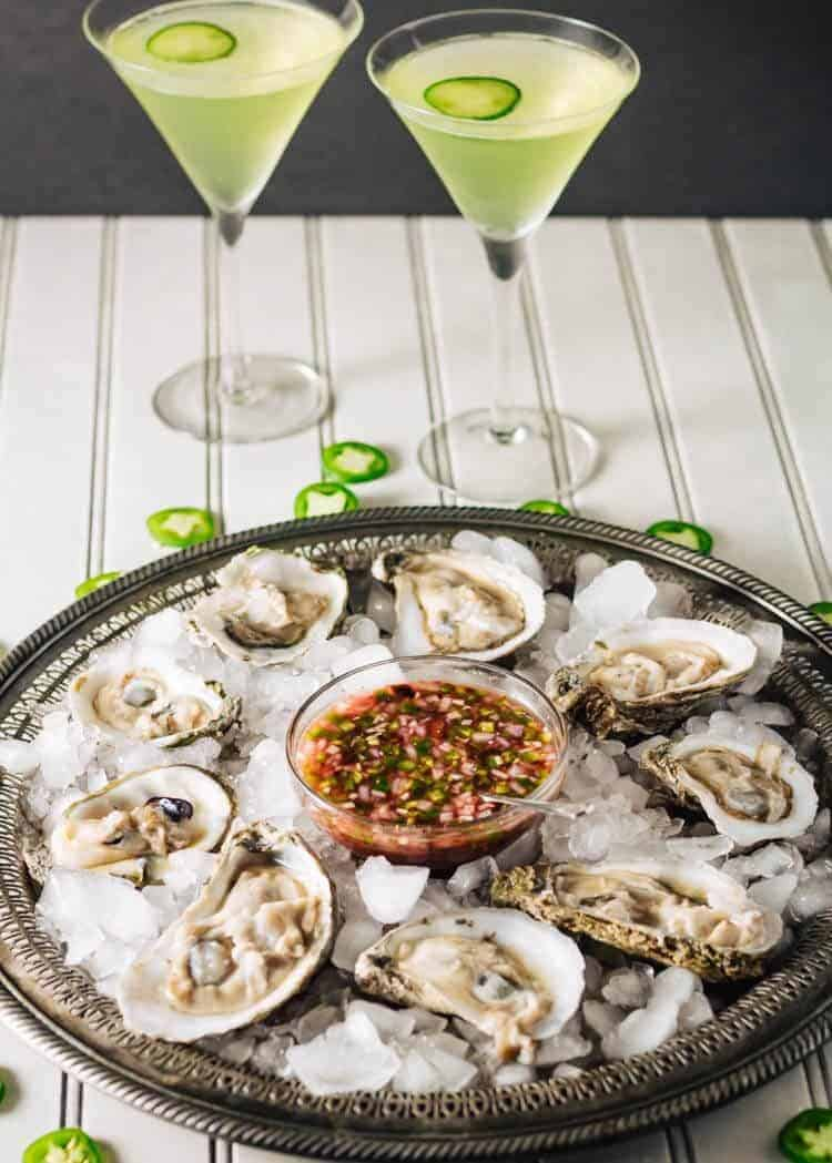 Oysters on the Half Shell with Blood Orange Mignonette on an antique silver platter with 2 cucumber lemon basil martinis.