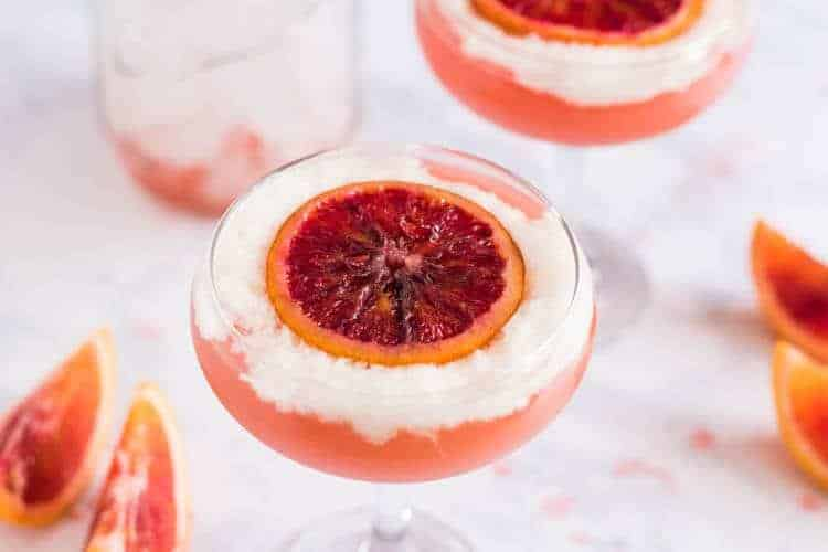 Original 2017 photo of A Blood Orange Pisco Cocktail with candied blood orange on top.