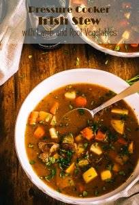 """Tender lamb cubes with earthy root vegetables in a savory stew flavored with herbs and (of course) stout... Pressure Cooker Irish Stew is a great option for St. Patrick's Day, but I'll bet the """"luck of the Irish"""" you'll love it any day! #instantpotrecipes #pressurecookerrecipes #Irishstewrecipe #stewrecipes #StPatrick'sDayrecipes #Irishrecipes"""