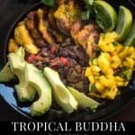 Tropical Buddha Bowls with mango salsa, black beans, fried plantains, and avocados in a black ceramic bowl.