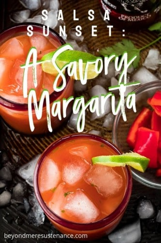 2 Savory Margaritas with a lime slice and red bell peppers in a bowl.
