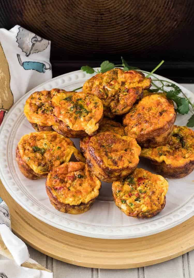 Mexican Mini-Frittatas with Chorizo and Cotija on a white plate with a dark background.
