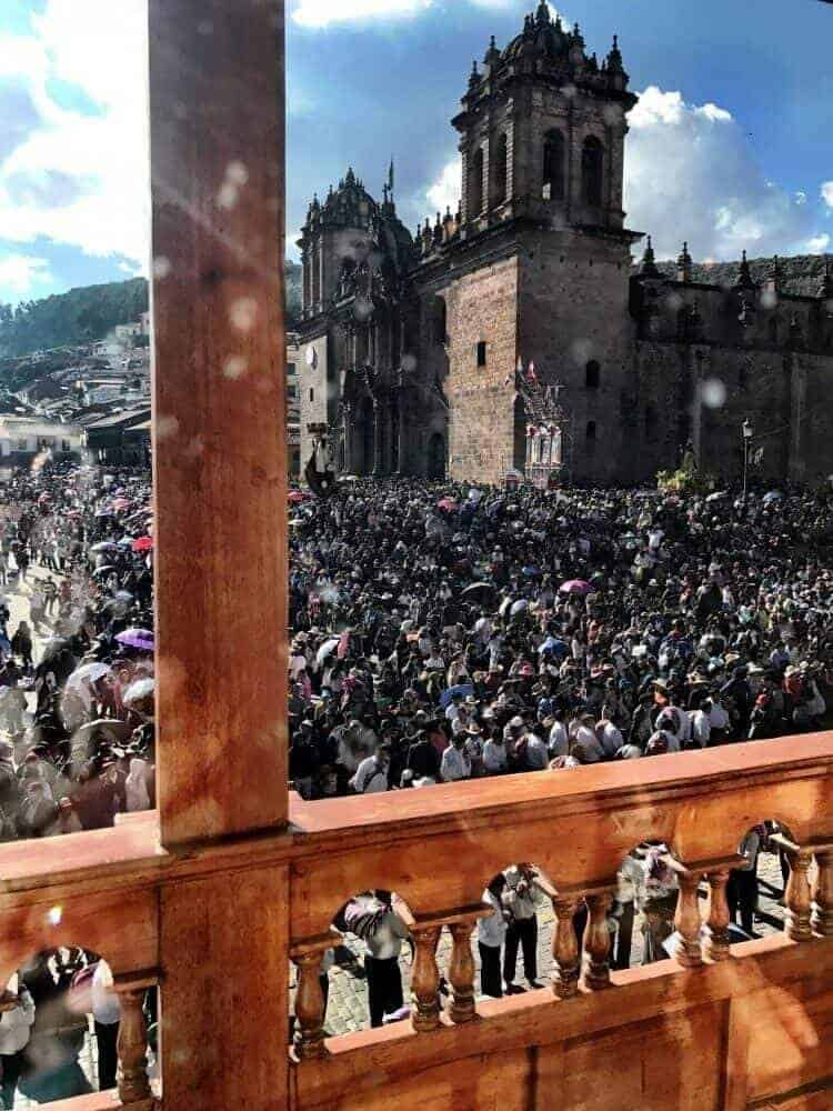 Inti Raymi crowds on the Plaza de Armas from a second floor balcony.