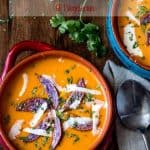 A fresh and creamy soup light enough to enjoy as a starter course even in summer... Creamy Tomato Bisque Peruvian-Style - at once familiar and exotic - will have you licking your bowl and asking for more! #glutenfree #souprecipes #tomatobisque #healthysoups #cleaneating #Peruvian