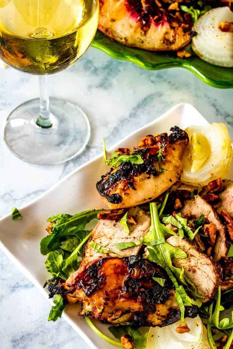 Arugula Salad with Grilled Pork and Peaches and Maple Bourbon Vinaigrette Hero