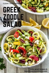Greek Zoodle Salad in a white ceramic bowl is vegetarian, clean, gluten free, quick and easy, and delicious!