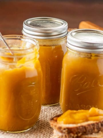 Instant Pot Pumpkin Butter in a jar with a small spoon close up.