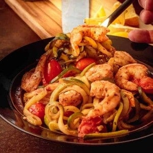 15 Minute Shrimp Zoodles Turkish Style - a fork in a bowl of shrimp zoodles - square image.