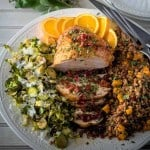 A Cozy Thanksgiving Dinner For Two - shaved brussels, turkey breast, farro dressing on a white platter.