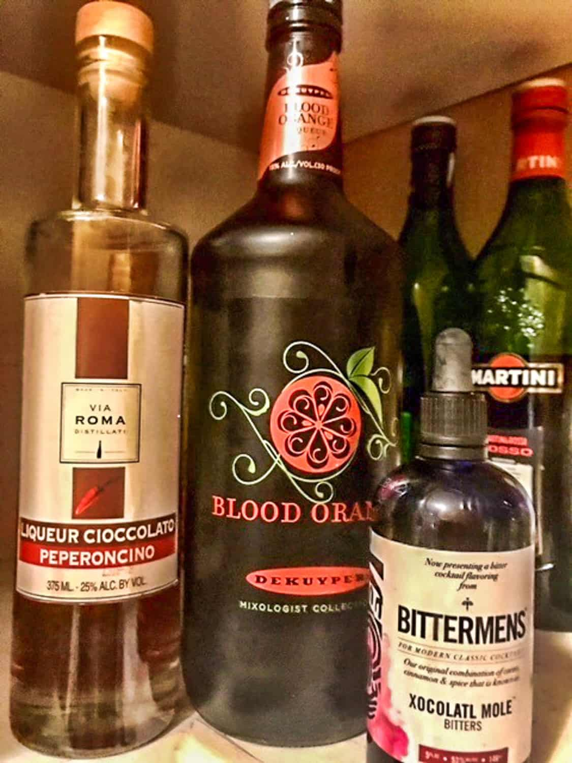 Mexican Manhattan or South-O-the-Border Sidecar Liqueurs ingredients before mixing.