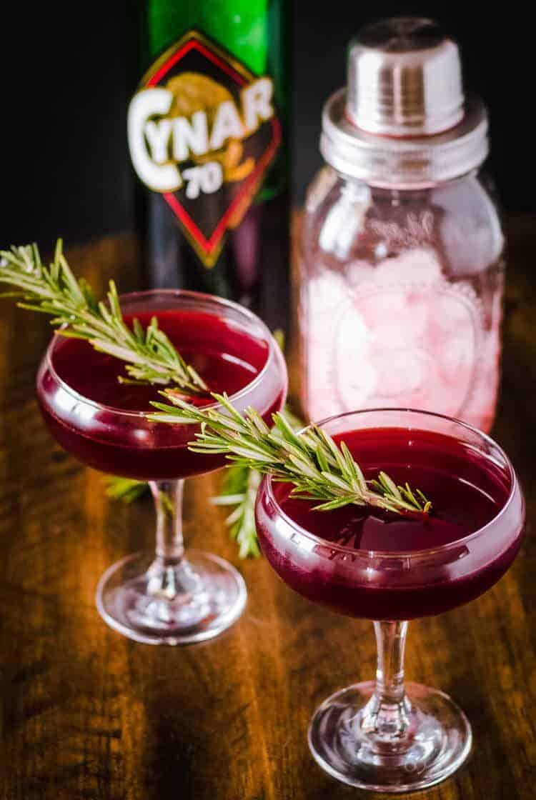 Savory Gin Cocktail with Cynar and Beet Juice with Cynar bottle
