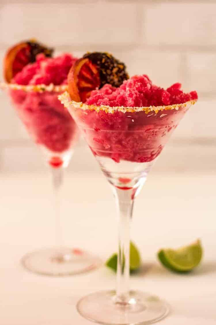 Blood Orange Margarita Sorbet in martini glasses with chocolate dipped oranges.