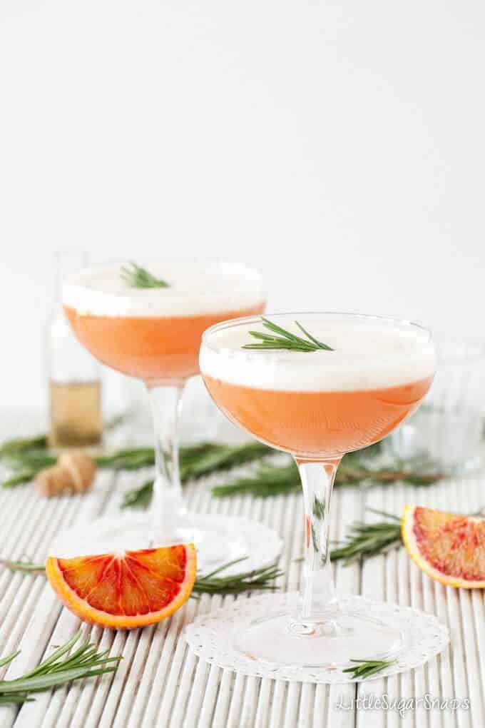 A blood Orange and Rosemary Martini with egg white foam