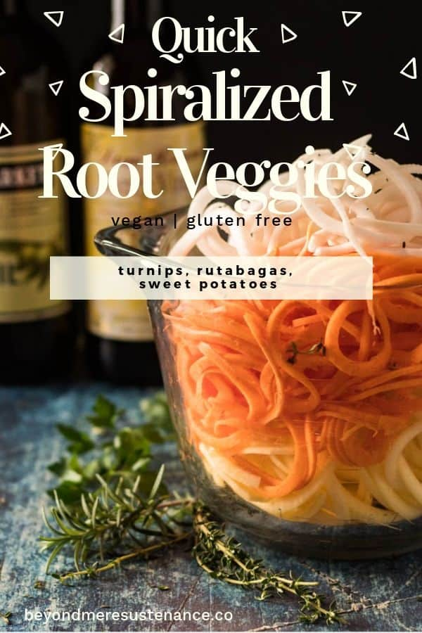 A glass 8 cup pitcher full of spiralized turnips, rutabagas, and sweet potatoes, herbs, olive oil, sherry vinegar in the background.