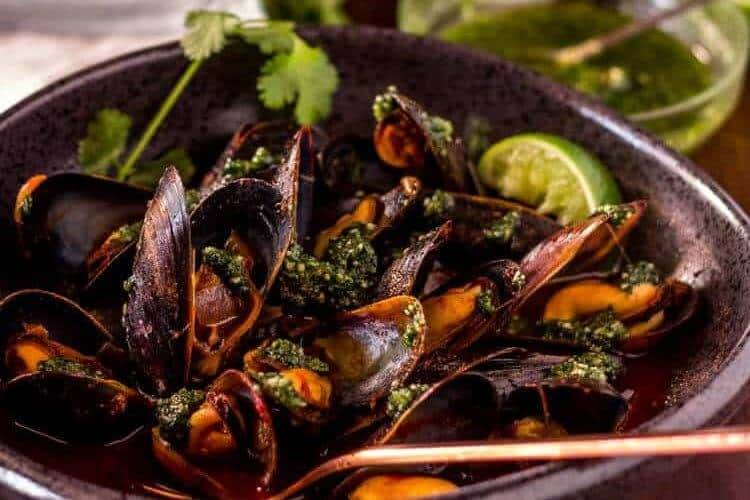 "<span class=""entry-title-primary"">Red Chile Mussels with Cilantro Pesto</span> <span class=""entry-subtitle"">New Mexico Style</span>"