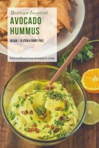 Tortilla chips and salsa, or hummus and pita chips? With my Mexican-Inspired Hummus with Avocado, you get the best of both worlds! Creamy avocado and puréed chick peas (don't forget the tahini) cozy up with a jalapeño, fresh cilantro, olive oil, and a combination of citrus juices. #avocadohummus #hummusvariations #hummusrecipes #vegandips #dairyfreedips #snackrecipes #healthydips #healthyhummus
